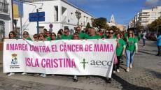Una gran marea verde ha recorrido Isla Cristina contra el Cáncer de Mama